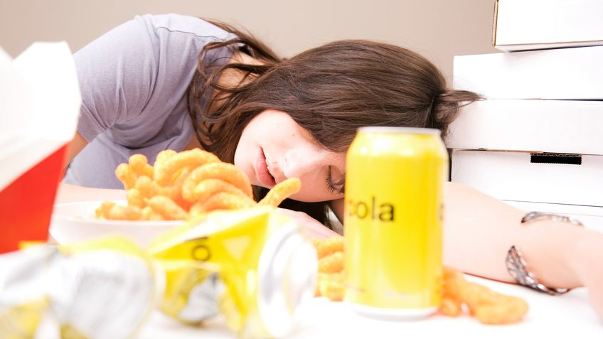 Woman sleeping after eating a lot of food